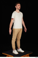 Trent brown trousers casual dressed standing white sneakers white t shirt whole body 0008.jpg